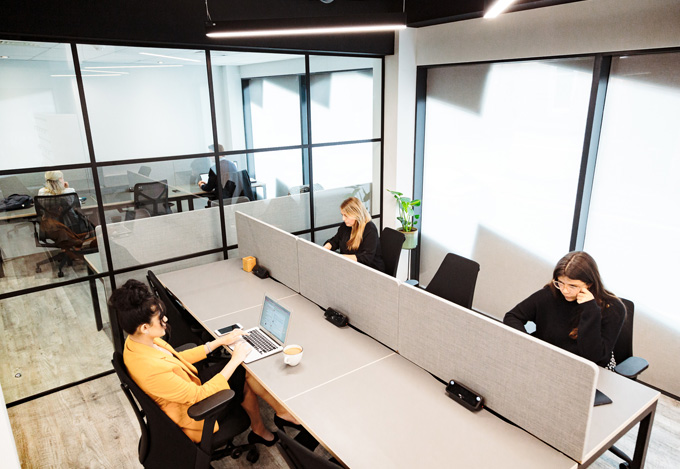 colleagues working in private office space