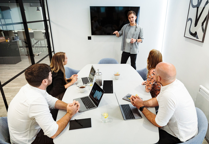 colleagues in private meeting room